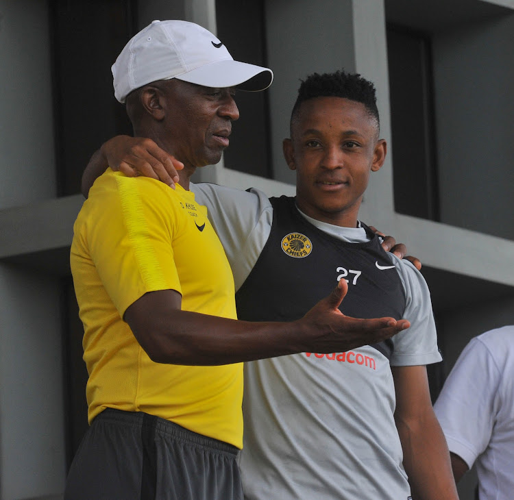 Kaizer Chiefs development coach Ace Khuse (L) chats to attacking midfielder Hendrick Ekstein (R) during the club's media day at Naturena in the south of Johannesburg on February 5 2019.