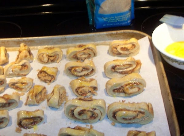 Place each roll with the point uo on a slightly greased baking sheet..Then with...