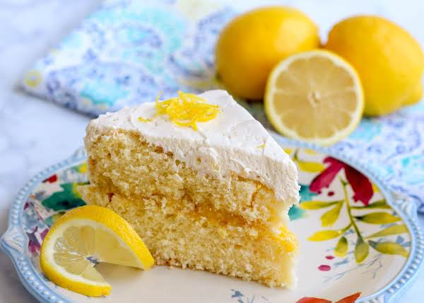 A Slice Of Southern Lemon White Cake With Lemon Curd.