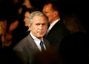 Photo: President Bush looks back toward the crowd after finishing speaking to the Greater Cleveland Partnership in Cleveland, Tuesday, July 10, 2007. (AP Photo/Amy Sancetta)