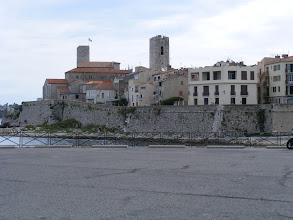 Photo: A closer view of the Old Town near the beach, with the church tower at center.