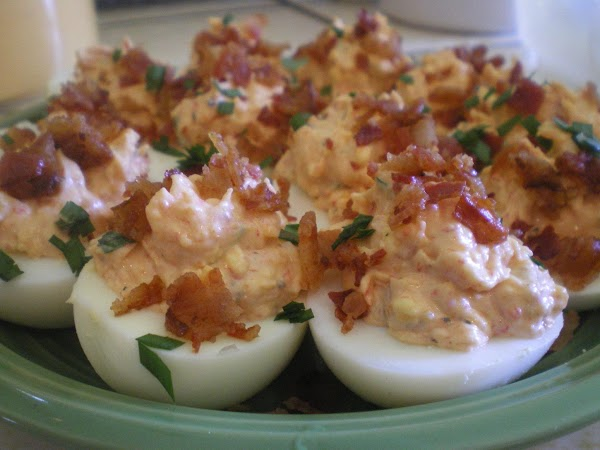 Fill egg halves with mixture generously.  Dice bacon and sprinkle over the top....