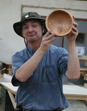 Photo: Tom Ankrum proudly displays a white oak bowl with a nicely balanced grain pattern.