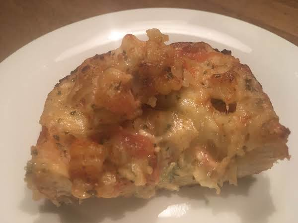 French Bread Topped With Crawfish, Seasonings & Cheese.  Baked Until Bubbly.. A South Louisiana Specialty.