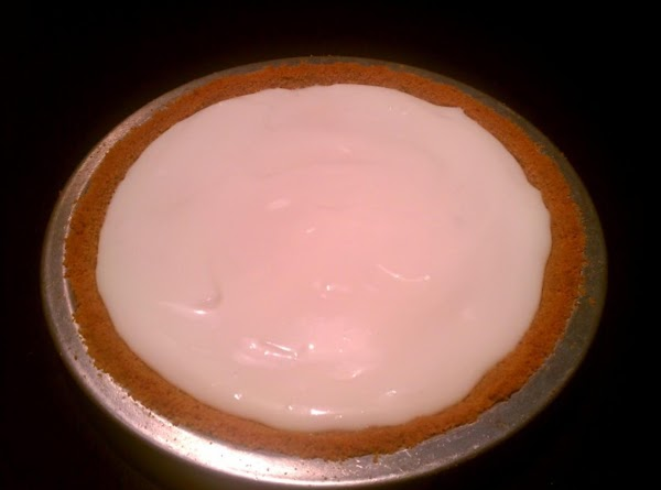 Whip the topping ingredients and gently pour over the top of the pie, covering...