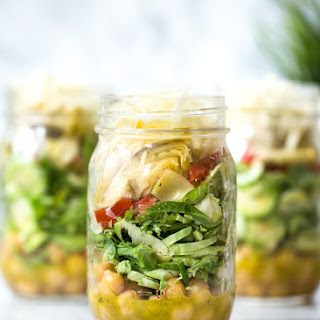 Raw Brussels Sprouts and Chick Pea Salad in a Jar with Artichokes, Sun Dried Tomatoes and Asiago.