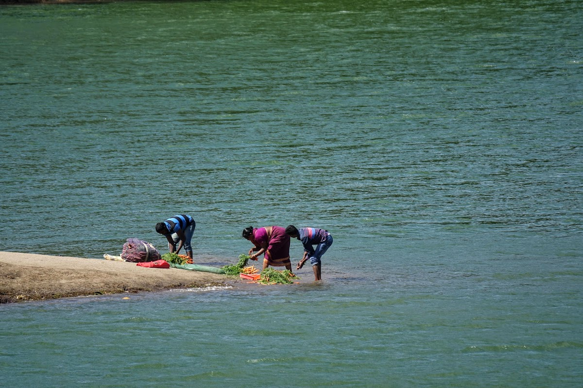 India. Kerala Motorbike Road Trip. Villagers by the Mattupatti Dam