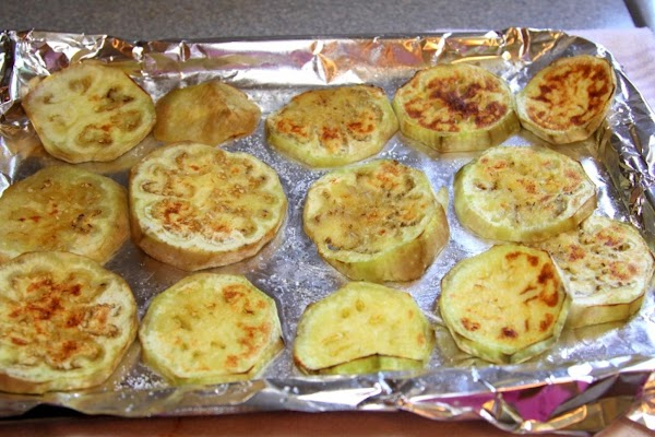 Turn on oven broiler.  Place eggplant on broiler pan and brush with oil....