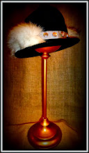 Photo: <KAPELUXE> Unique-Chique Hats by Luba Bilash ART & ADORNMENT  Midnight black wool felt fedora base; fox tail; feathers; light grey grosgrain ribbon; silver-plated fleur-de-lis beads 360 degree possibilities Can also be worn on an angle Size L - 56 cm/22 in SOLD