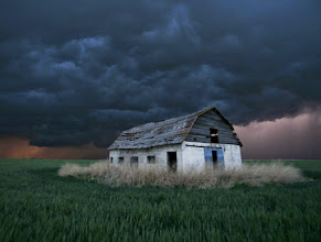 Photo: An old barn stands in a wheat field as a sever thunderstorm passes in the distance near Ogallah, Kan., Thursday, May 22, 2008. Severe thunderstorms dropped tornadoes across much of northwest Kansas. (AP Photo/Charlie Riedel)??