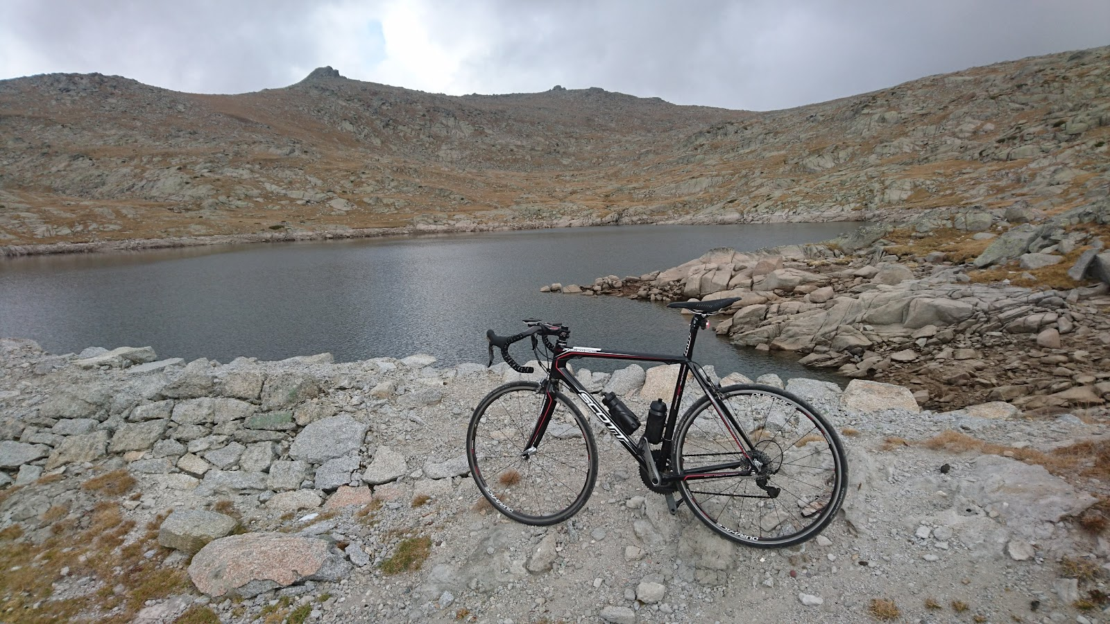 Rila climb by bike - bicycle at dam and reservoir