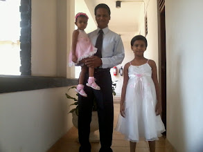 Photo: Sisters with Grandpa, all dressed up to attend a Home Coming at the Peradeniya Guest House.