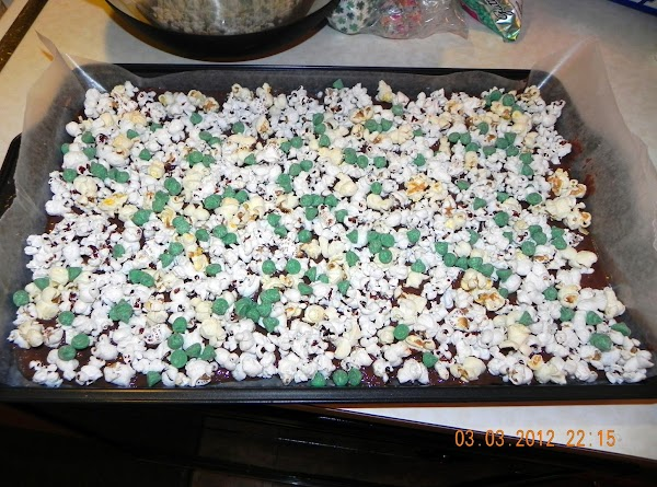 Pop your popcorn, salt it and set aside. Line a cookie pan with wax...