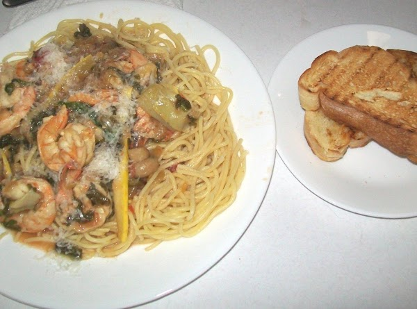 Serve over pasta and freshly grated cheese, and toasted baguette bread.