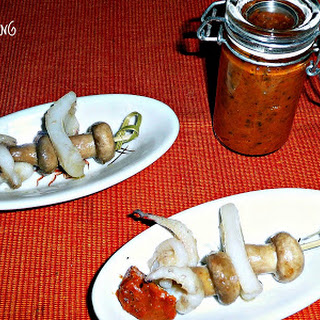 Mini Mushroom and Cuttlefish Skewer with Spicy Sauce.