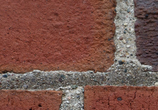 Photo: Upper left corner of a brick wall. Softer but not unworkable corners at F/2.8; looks better if you apply some sharpening, but no miracle cure. All tests on Canon 5D Mark III.