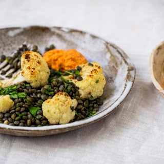 Roasted Cauliflower And Lentil Salad With Red Pepper Sauce.