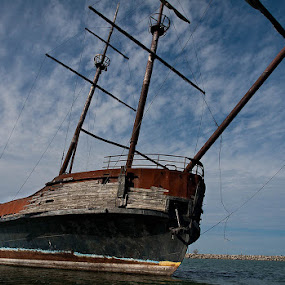 Abandoned Ship by Tanya Witzel - Transportation Boats ( canon, clouds, water, old, pirates, ship, sail, lake, rust, boat, deck, abandoned )