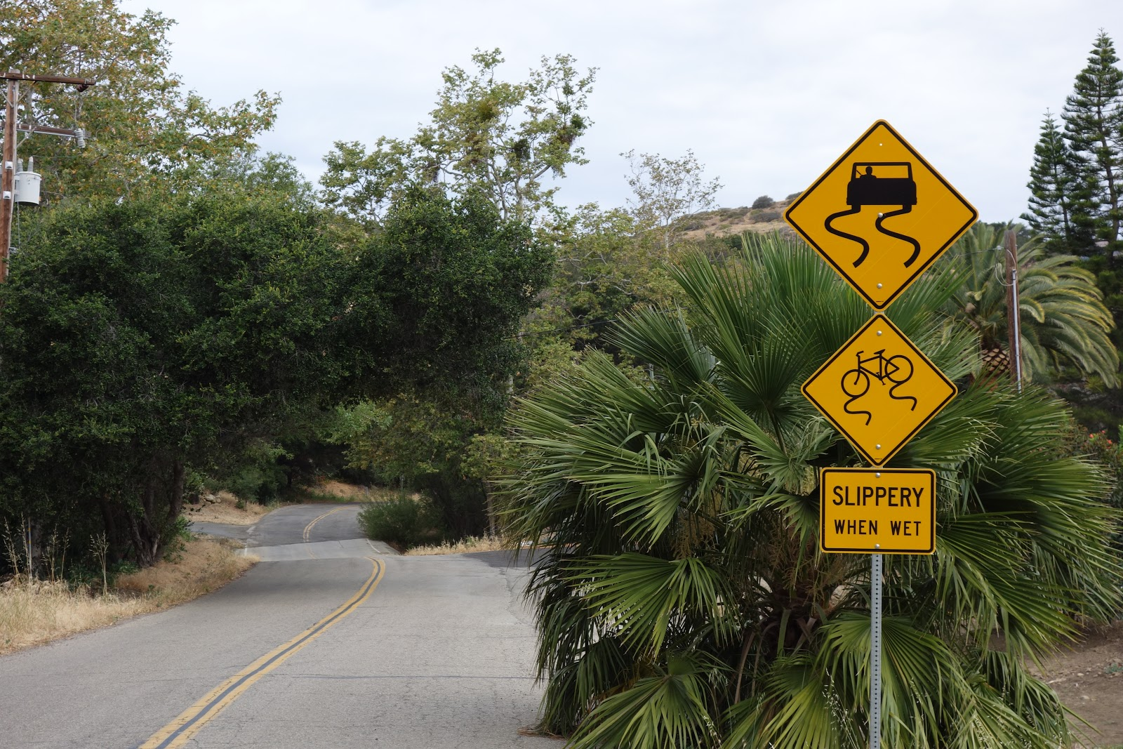 Climbing Refugio Road by bike - road and bicycle sign