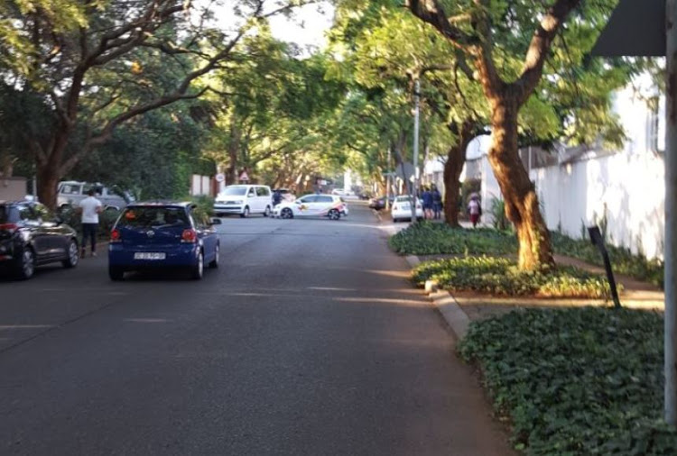 The Hawks were outside the controversial Gupta family's home in Saxonwold on 14 February 2018. Image: Sthembiso Msomi