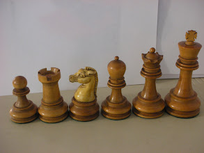 Photo: CH67: Staunton-based set by the British Chess Company - 1890's; King=3 3/8ths in. Knights with Xylonite (early plant- based plastic) heads. Xylonite was essentially the same as Parkesine - the first man-made plastic in c.1862; Parkesine failed in 1868, but the material was taken up by the Xylonite Company in 1869. The use of this by BCC is probably the first instance of a plastic chess-man. Sadly, they weren't popular - although I love them: they can take on an appearance akin to Meerschaum , a clay used to produce (smoking) pipes.  For more images of this set see http://tinyurl.com/7qhd8qt