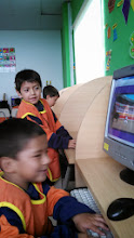 Photo: Day 7: These are some of the kids at Los Camanitos de Luz, a PreK and Kindergarten school that we visited on the trip. This was the computer class.