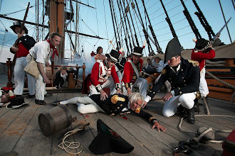 Photo: Nelson falls to the deck, mortally wounded, as the battle rages around him.