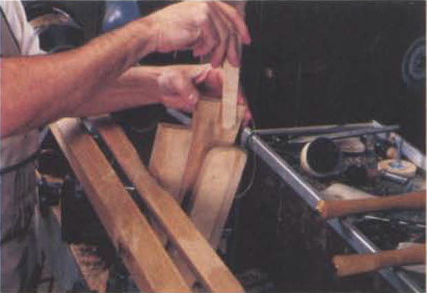 6. Push down the wedge until the spindle is deflected just a bit, and lock the main wedge in place with the secondary locking wedge.