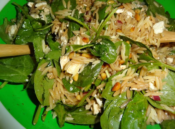 Mix orzo with spinach mix.  Pour dressing over salad.