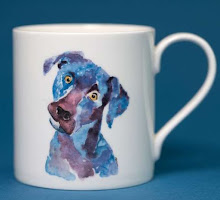 a mug with a printed watercolour of a labrador on it