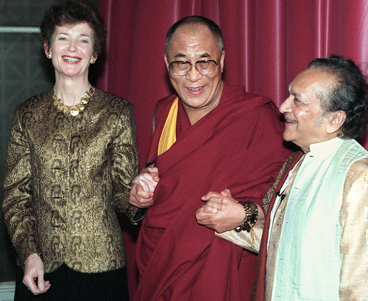 Photo: NEW YORK, UNITED STATES:  The Dalai Lama (C), spiritual leader of Tibetan Buddhists, is joined by Indian sitarist Ravi Shankar (R) and United Nations High Commissioner for Human Rights Mary Robinson (L) prior to being honored with a Juliet Hollister Award 05 May in New York. The award is given by the Interfaith Center of New York and the Temple of Understanding to religious or secular figures who promote greater understanding of spiritual values.   AFP PHOTO    Henny Ray ABRAMS (Photo credit should read HENNY RAY ABRAMS/AFP/Getty Images)