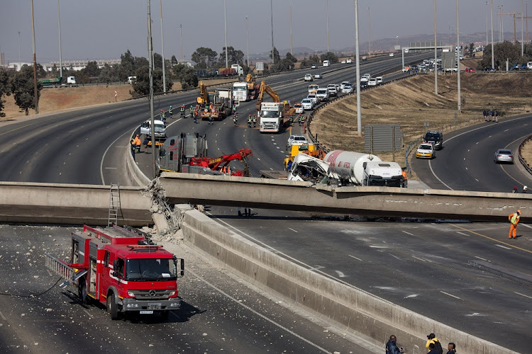 Workers cleared a pedestrian bridge that collapsed on the N3 highway in Johannesburg. Picture: THE TIMES