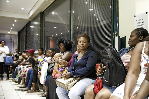 Parents queue at the Gauteng education department in a bid to secure school placements for their children. File Picture: THE TIMES