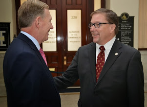 Photo: BBA President Paul Dacier ran into Senator Richard Ross and took the opportunity to ask him about increased funding for civil legal aid.