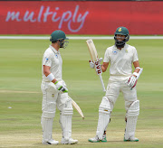 Hashim Amla of South Africa is congratulated by Dean Elgar of South Africa on getting his fifty runs during day 3 of the 2018/19 Castle Lager Test Series match between South Africa and Pakistan at SuperSport Park, Centurion on 28 December 2018.