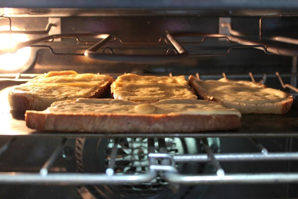 When the bread is golden brown and crispy, move the slices to a baking...