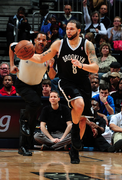Photo: Deron Williams #8 of the Brooklyn Nets drives up-court against the Atlanta Hawks on January 16, 2013 at Philips Arena in Atlanta, Georgia.