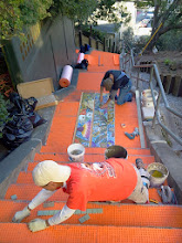 Photo: Third full day of work (October 29, 2013) with KZ Tile workers (Sing in foreground, Ton below) installing the first sections of the Hidden Garden Steps (16th Avenue, between Kirkham and Lawton streets in San Francisco's Inner Sunset District) 148-step ceramic-tile mosaic designed and created by project artists Aileen Barr and Colette Crutcher. For more information about this volunteer-driven community-based project supported by the San Francisco Parks Alliance, the San Francisco Department of Public Works Street Parks Program, and hundreds of individual donors, please visit our website at http://hiddengardensteps.org.