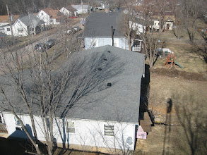 Photo: Neighbors to the Right. And my shadow in their back yard.