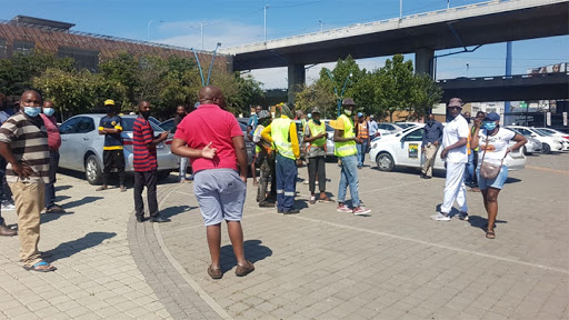 Drivers parked outside the Gauteng Public Transport and Roads Infrastructure offices.