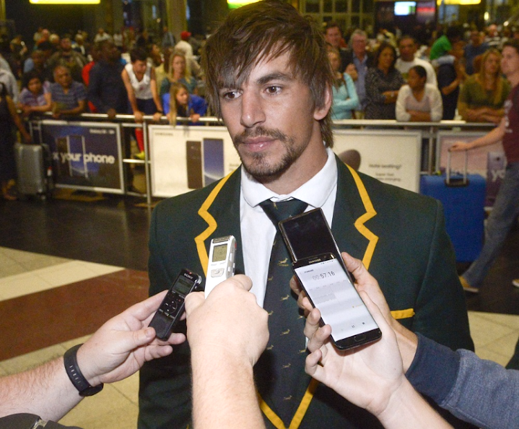 Captain Eben Etzebeth of the Springboks takes questions at OR Tambo International Airport after the team's return from New Zealand on Sunday. Picture: GALLO IMAGES