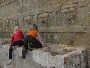 Photo: ... kids on an old water fountain