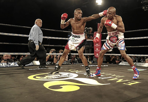 Lusanda Komanisi throws a punch before he was knocked out by Michael Mokoena at Emperors Palace.
