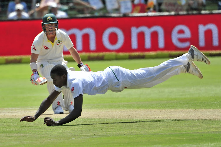 David Warner of Australia stays put as Kagiso Rabada of the Proteas dives to save the runs off his own bowling during day three of the second 2018 Sunfoil Test match between South Africa and Australia at St George's Park, Port Elizabeth on 11 March 2018.