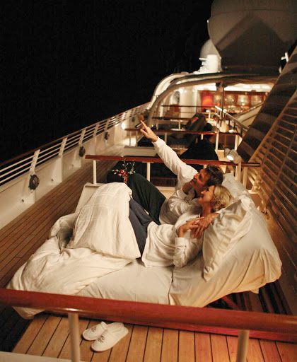 Seadream-lounges-night.jpg - Gaze at the star on deck with that special someone on your SeaDream cruise.