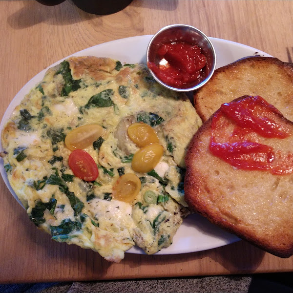 Greek frittata, gluten free toast and strawberry jam.