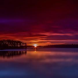 Red Sunset by Jarmo Haikonen - Landscapes Sunsets & Sunrises ( clouds, sky, midnight, sunset, finland, lake, landscape, sun )