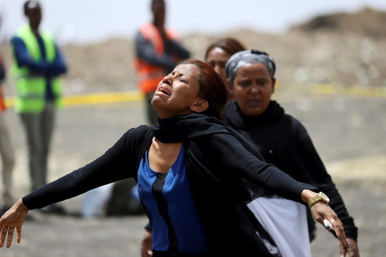 A relative mourns at the scene of the Ethiopian Airlines Flight ET 302 plane crash, near the town Bishoftu, near Addis Ababa, Ethiopia March 14, 2019.