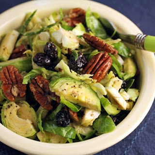 Shredded Brussels sprouts salad with dried blueberries, pecans, and maple-miso dressing