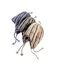 """Photo: HANIA by ANYA COLE Natural, grey marl and lavender hand-knit cashmere """"Juliet"""" hat with braids. $250. USA. Main Floor. 212 872 8775"""